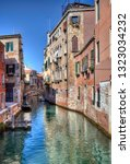 historical houses on a canal... | Shutterstock . vector #1323034232