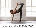 attractive woman in grey... | Shutterstock . vector #1323042545