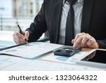 businessman accountant working... | Shutterstock . vector #1323064322