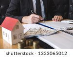 client signing agreement... | Shutterstock . vector #1323065012