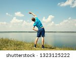 athletic young man doing... | Shutterstock . vector #1323125222