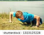 athletic young man doing... | Shutterstock . vector #1323125228