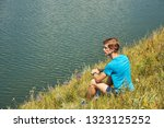 athletic young man outdoors.... | Shutterstock . vector #1323125252