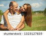 young happy couple in love.... | Shutterstock . vector #1323127835