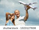 portrait of a couple outdoors... | Shutterstock . vector #1323127838