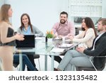 business team preparing for a... | Shutterstock . vector #1323135482