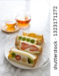 tea time home made fruit... | Shutterstock . vector #1323171272