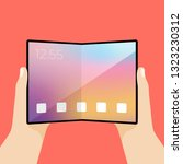 foldable screen phone in hand.... | Shutterstock .eps vector #1323230312