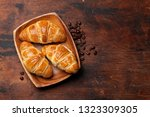 fresh croissants and coffee... | Shutterstock . vector #1323309305