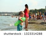 kids are resting on the public... | Shutterstock . vector #1323314288