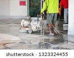 worker polishing stone concrete | Shutterstock . vector #1323324455