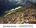 view from a rocky mountain on a ... | Shutterstock . vector #1323337322