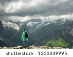 male traveller on the top of... | Shutterstock . vector #1323339995