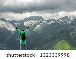 happy traveller on the top of... | Shutterstock . vector #1323339998