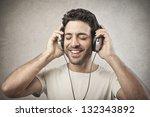 Man Listens Music With...