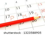 sheet monthly calendar with red ... | Shutterstock . vector #1323588905