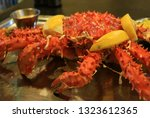 big plate of steamed whole king ... | Shutterstock . vector #1323612365