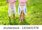 kids with eggs basket and bunny ...   Shutterstock . vector #1323651578
