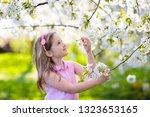kids play in spring park.... | Shutterstock . vector #1323653165