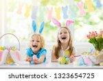 kids dyeing easter eggs....   Shutterstock . vector #1323654725
