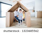 a portrait of young family with ... | Shutterstock . vector #1323685562
