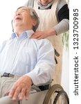stiff shoulder  massage  senior | Shutterstock . vector #1323700985