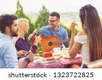 group of friends having a... | Shutterstock . vector #1323722825