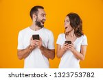 image of excited couple man and ... | Shutterstock . vector #1323753782