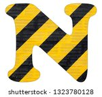 letter n   yellow and black... | Shutterstock . vector #1323780128
