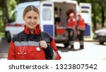 Female Paramedic Smiling Into...