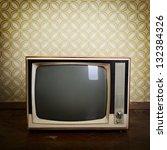 retro tv with wooden case in... | Shutterstock . vector #132384326
