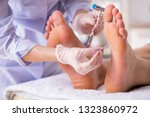 podiatrist treating feet during ... | Shutterstock . vector #1323860972