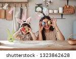 smiling and holding eggs.... | Shutterstock . vector #1323862628