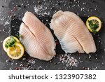 fresh raw fillet white fish... | Shutterstock . vector #1323907382