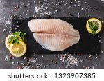 fresh raw fillet white fish... | Shutterstock . vector #1323907385