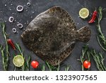 raw whole flounder fish with... | Shutterstock . vector #1323907565