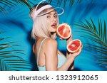 lovely girl wearing blue... | Shutterstock . vector #1323912065