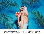 blonde girl with nude make up... | Shutterstock . vector #1323912095