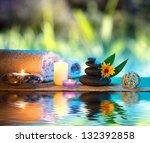 three candles and towels black... | Shutterstock . vector #132392858
