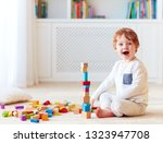 cute toddler baby boy playing...   Shutterstock . vector #1323947708