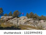 woman in the distance standing... | Shutterstock . vector #1323994592