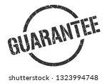 guarantee black round stamp | Shutterstock .eps vector #1323994748