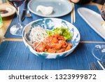 red salmon tartare with green... | Shutterstock . vector #1323999872