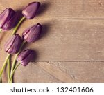 Stock photo tulips on wooden background 132401606