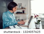 woman wearing denim shirt using ... | Shutterstock . vector #1324057625