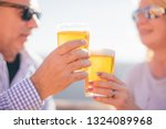 Retired Couple Drinking Beer In ...