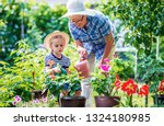 gardening with kids.... | Shutterstock . vector #1324180985