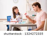 male sperm donor visiting clinic | Shutterstock . vector #1324272335