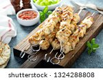 chicken kebabs on a board with... | Shutterstock . vector #1324288808