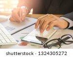 businessman or accountant... | Shutterstock . vector #1324305272